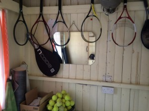 Ladies changing room with spare tennis equipment