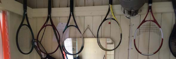 Tennis racquets hung up in the Cresent Lawn Tennis Club changing room
